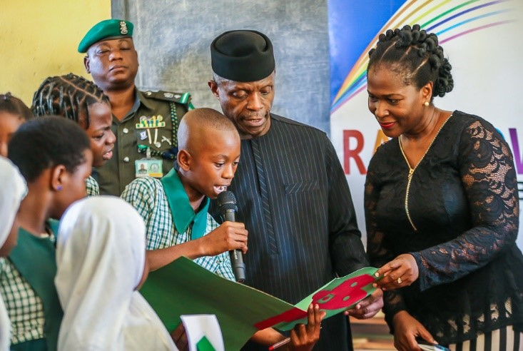 Students of LEA Primary School, Life Camp, Abuja, present a handmade card to the Vice President and Mrs Kalango after a reading with the VP to mark World Book & Copyright Day (April 23rd) 2018