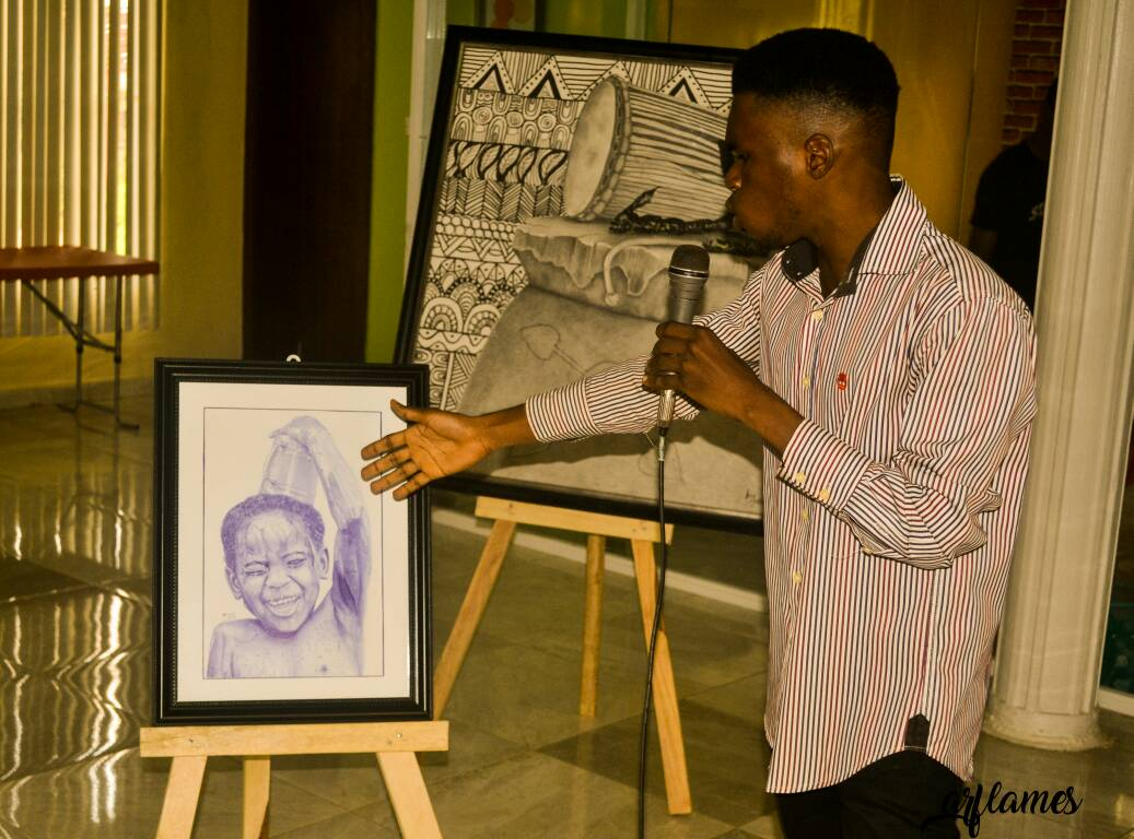 Onome Joshua talking about his artwork