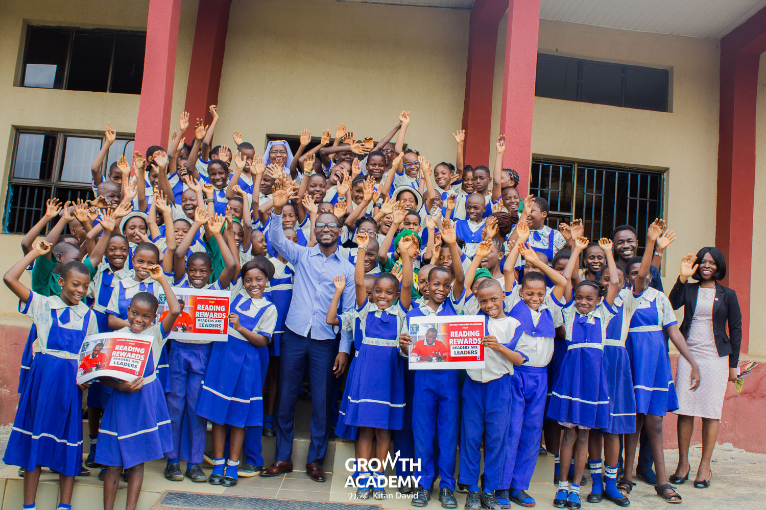 Bayode and pupils of Bishop Hughes Nursery and Primary School. Akure
