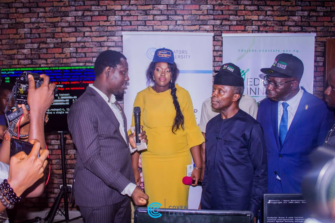 Outcomes Advisor Coven Labs and Philanthropies Lead at Microsoft, Sola Amusan, explaining the activities of the Curators University to Vice President Osinbajo